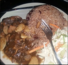 Oxtail served with Rice and Peas